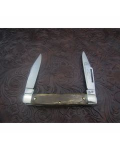 Original Colonel Coon Muskrat knife 4 inches mint condition with Beautiful bone handles and carbon steel blades with plain blade edge