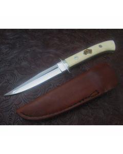 George Herron custom Boot knife 4.25 inch blade Walrus Ivory handles with custom scrimshaw work stainless steel plain blade edge