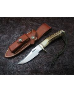 Randall Made Knives Model 8 Bird and Trout with 3.188 inch 440 stainless steel blade with a Stag handle with red, white and black spacer's nickel silver single hilt guard